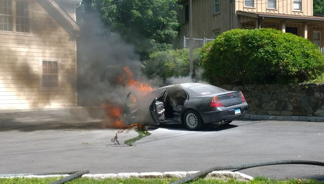 Car erupts into flames only minutes after two women and a child were pulled to safety on July 11, 2014.