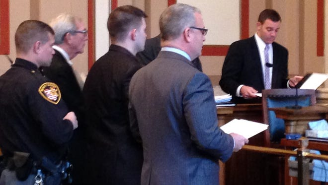 Shawn Allen, standing to the left of his attorney, William Rapp, in Hamilton County Common Pleas Court on Thursday.