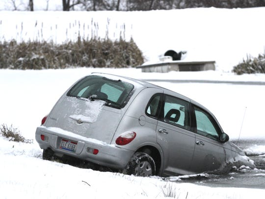 A car went partially into a pond on Ohio 309 in Ontario