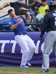 Peter Alonso catches this foul ball for the out at