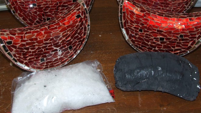 The ceramic watermelons and seized drugs.