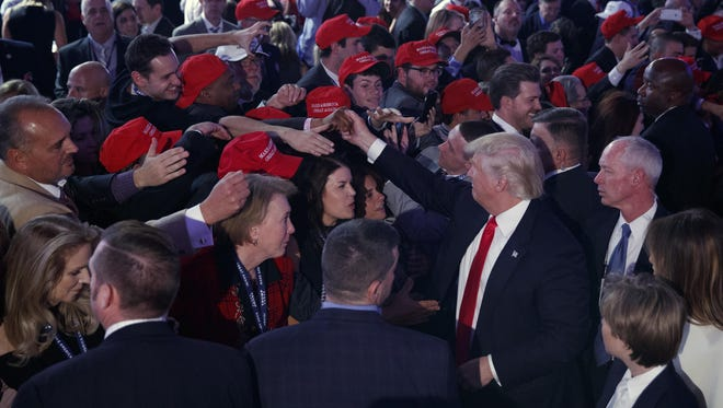 President-elect Donald Trump shakes hands during an election night rally, Wednesday, Nov. 9, 2016, in New York.