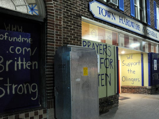 In the days after a crash in the center of Black Mountain left Montreat College track and field coach Britten Olinger fighting for his life in 2017, members of the community expressed their support in various ways, including painting encouraging words on the plywood that boarded up the windows at Town Hardware & General Store.