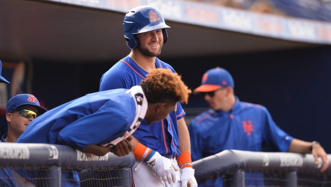 Tim Tebow shares a laugh with his St. Lucie Mets teammates during a doubleheader against the Palm Beach Cardinals on Wednesday, June 28, 2017, at First Data Field in Port St. Lucie.