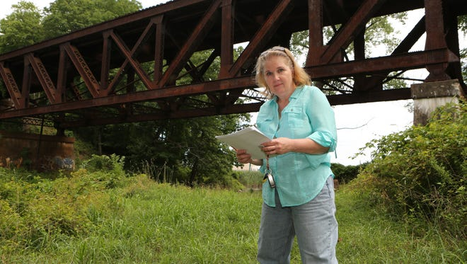 Susan Filgueras, a Tomkins Cove resident who filed a Freedom of Information request with the state DOT for records of accidents involving CSX trains, stands near a trestle in Stony Point, Aug. 8, 2016.