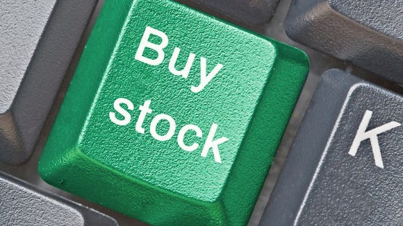 a buy stock button on a keyboard