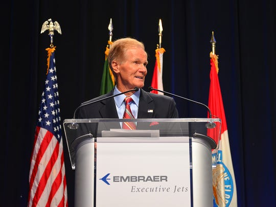 Senator Bill Nelson at the podium. Gov. Rick Scott, U.S. Sen Bill Nelson, U.S. Congressman Bill Posey, plus state and local officials and business leaders were in attendance at Orlando Melbourne International Airport Thursday morning for a ribbon-cutting at Embraer Executive Jets Legacy jet assembly operation.