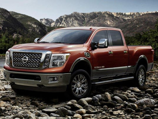 new nissan titan takes macho looks to extreme. Black Bedroom Furniture Sets. Home Design Ideas