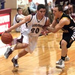 Morristown's Kevin Hoehn (20) drives to the hoop last winter.
