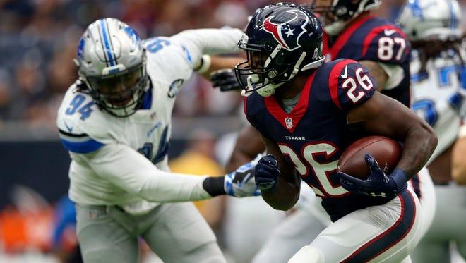 Houston Texans running back Lamar Miller runs as Detroit Lions defensive end Ziggy Ansah sets the edge Oct. 30, 2016.
