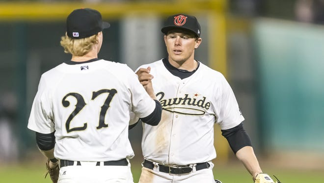 Visalia Rawhide infielder Marty Herum, left, and Austin Byler exchanges a handshake in a game earlier this season. Herum was named a 2017 California League All-Star.