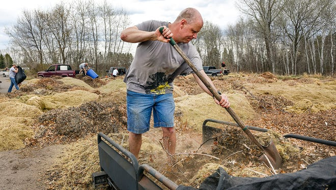 Rodney Pederson, Sartell, unloads his trailer full of leaves and grass Sunday, April 17, at the Sartell Compost Site. Pederson had also brought a load Saturday while taking advantage of the nice weather to rake his yard.