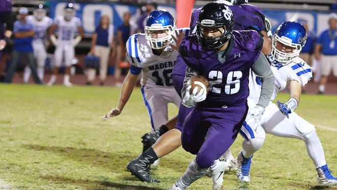 Mission Oak's Jose Palomera (28) rushes against Madera in a non-league football game on Thursday, Sept 1st, 2016