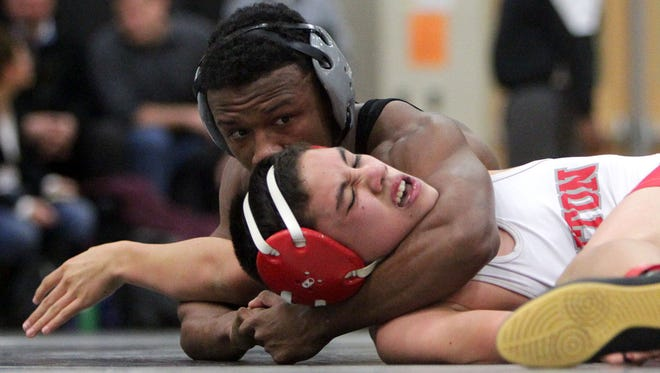 Plymouth 119-pounder Brandon Harris gets the upper hand on Canton's Ben Samoy Wednesday night.