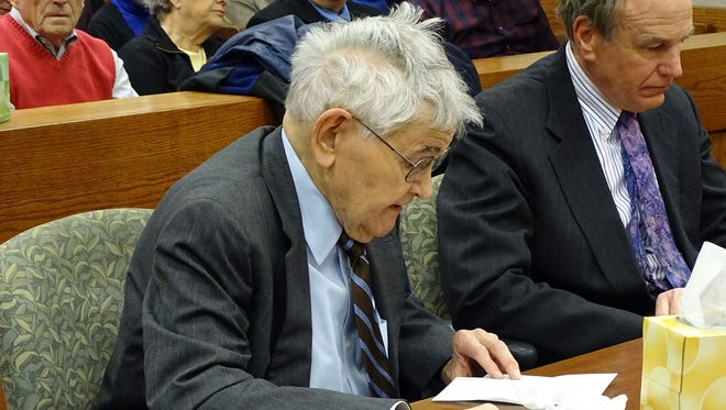 Lyman Leathers reads a letter from a friend during a sentencing hearing on Tuesday, Jan. 13, 2015, in Delaware Municipal Court on a charge of vehicular manslaughter. The charge stems from a two-vehicle crash in September which killed John and Lisa Schade. Leathers was fine $1,000 and his license suspended for four years. The crash occurred when Leathers fell asleep at the wheel.