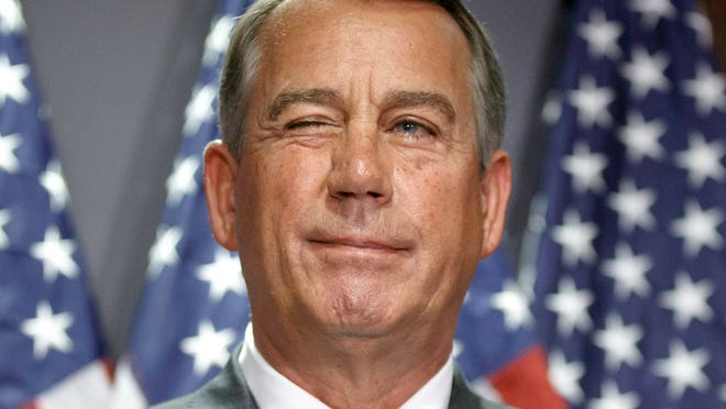 House Speaker John Boehner of Ohio gives a wink to a reporter as he answers questions with GOP leaders at Republican National Committee headquarters on Capitol Hill in Washington, Tuesday, July 15, 2014.