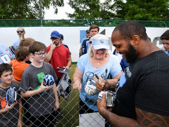 Titans defensive tackle Jurrell Casey (99) signs autographs for fans after practice at Saint Thomas Sports Park Wednesday, Aug. 1, 2018, in Nashville, Tenn.