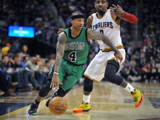 Former Boston Celtics guard Isaiah Thomas dribbles