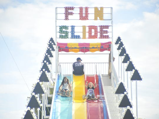 Children slide Saturday at the World's Fair in Bellville.