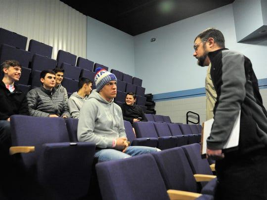 Lucas Pokorny talks to wrestlers from Owen High School