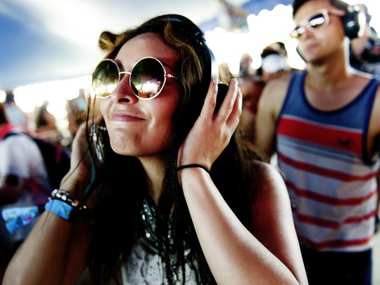 A festivalgoer listens to her headset in the Silent