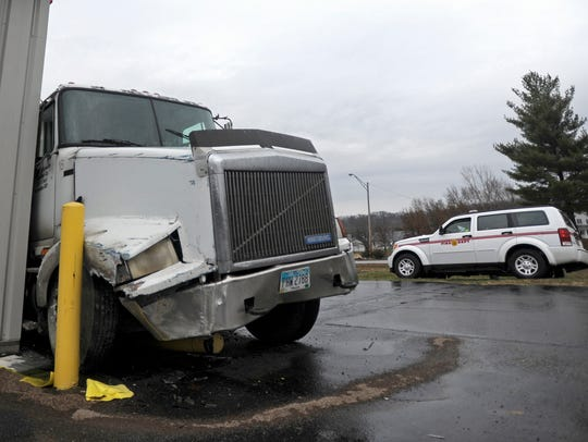 A logging truck crashed into Save-A-Lot on Western