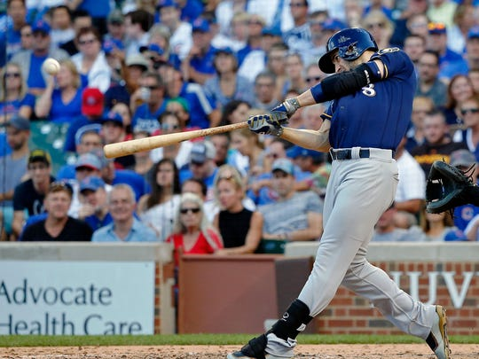 Ryan Braun hits his first home run Saturday against the Cubs in the sixth inning at Wrigley Field.