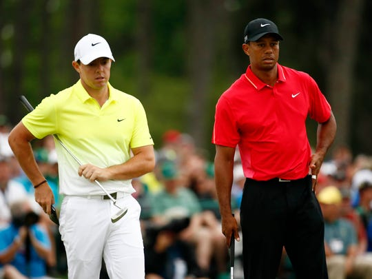 Tiger Woods, right, stands next to Rory McIlroy on
