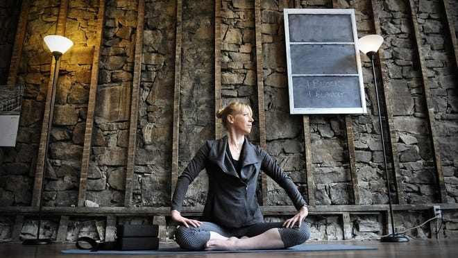 Karin Burke talks about her work as a yoga instructor at Return Yoga in downtown St. Cloud on April 9.