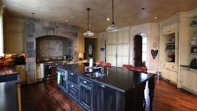 The large kitchen has honed granite counters.