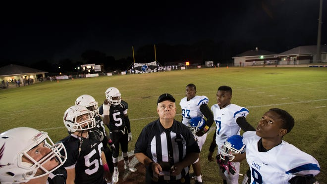 Sidney Lanier wide receiver Ladarius Smith (8) and Alabama Christian quarterback Chandler Taylor (7) watch the coin toss with other captains before the game on Friday on Wade's Field.