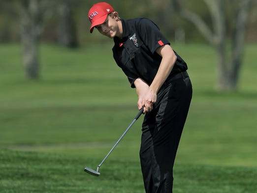 Penfield's Zak Ottman putts onto the 12th green during the Monroe County Tournament of Champions held at Deerfield Country Club on Tuesday, May 13, 2014.