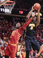 Iowa Hawkeyes forward Tyler Cook (5) pulls a rebound