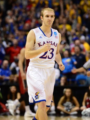 Kansas Jayhawks guard Conner Frankamp (23) celebrates after hitting a three-point shot at the end of the first half against the Stanford Cardinal in the third round of the 2014 NCAA Men's Basketball Championship at Scottrade Center.