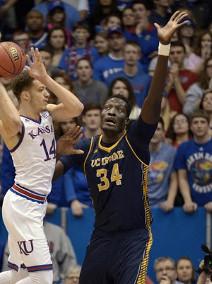UC Irvine center Mamadou Ndiaye, right, defends against Kansas on Dec. 29, 2015.
