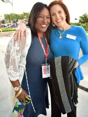 Jerusha Stewart shares a laugh with IRC school board member Tiffany Justice.