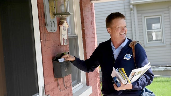 After 23 years walking the same route in Dover, mail carrier Greg Kocher delivered his last round in the borough on Thursday, April 13, 2017.