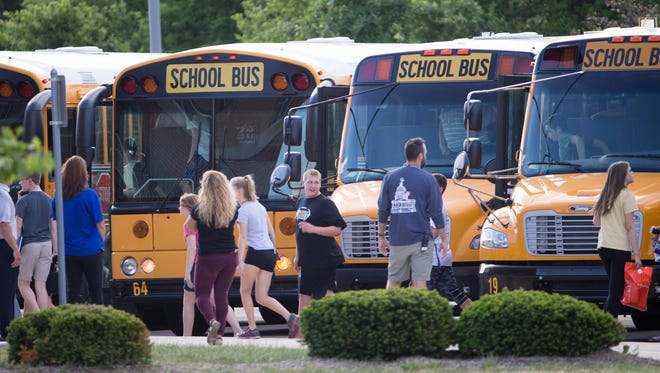 Students exit school buses on the first day back at Noblesville West Middle School, following Friday's shooting by a student that left a teacher and a student injured, Noblesville, Wednesday, May 30, 2018. The shooter is in custory after the school shooting.