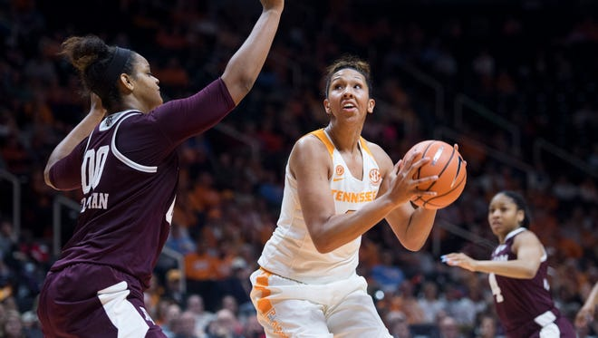 Tennessee's Mercedes Russell looks for the show while defended by Texas A&M's Khaalia Hillsman on Thursday, February 1, 2018.