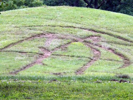 635724726669628876-071415serpent-mound-damage