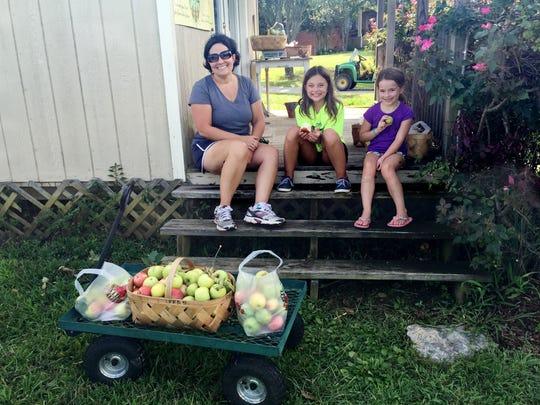Elise Buller and her daughters, Elizabeth, 9, and Vivian,