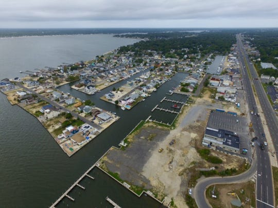 Toms River,  NJ    Aerial photos show property at the foot of the Tunney-Mathis bridge where developer Robert Grogan wants to  put a heliport for his personal use on the marina property he owns.  Photo courtesy of Jennifer Martin092315