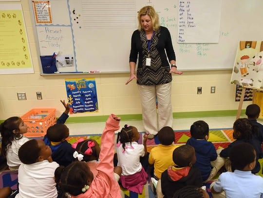 Kindergarten teacher Beverly Herbert asks a question