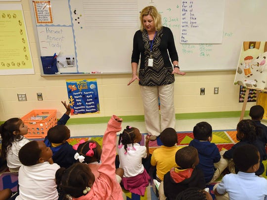 Kindergarten teacher Beverly Herbert asks a question in her classroom.