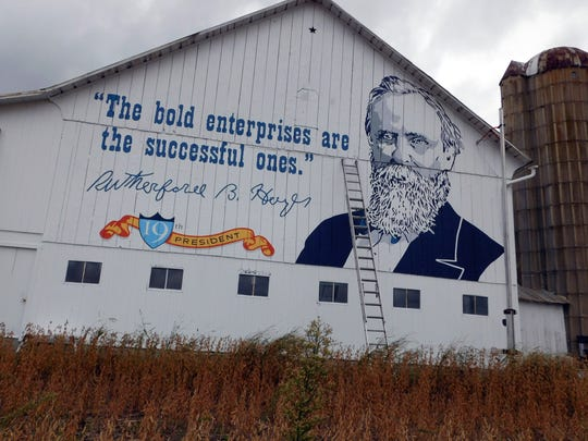 A mural honoring President Rutherford B. Hayes is painted Oct. 2, 2015, on a barn near the Ohio 53 exit of the Ohio Turnpike in Fremont, Ohio. The mural celebrates the turnpike's 60th anniversary.