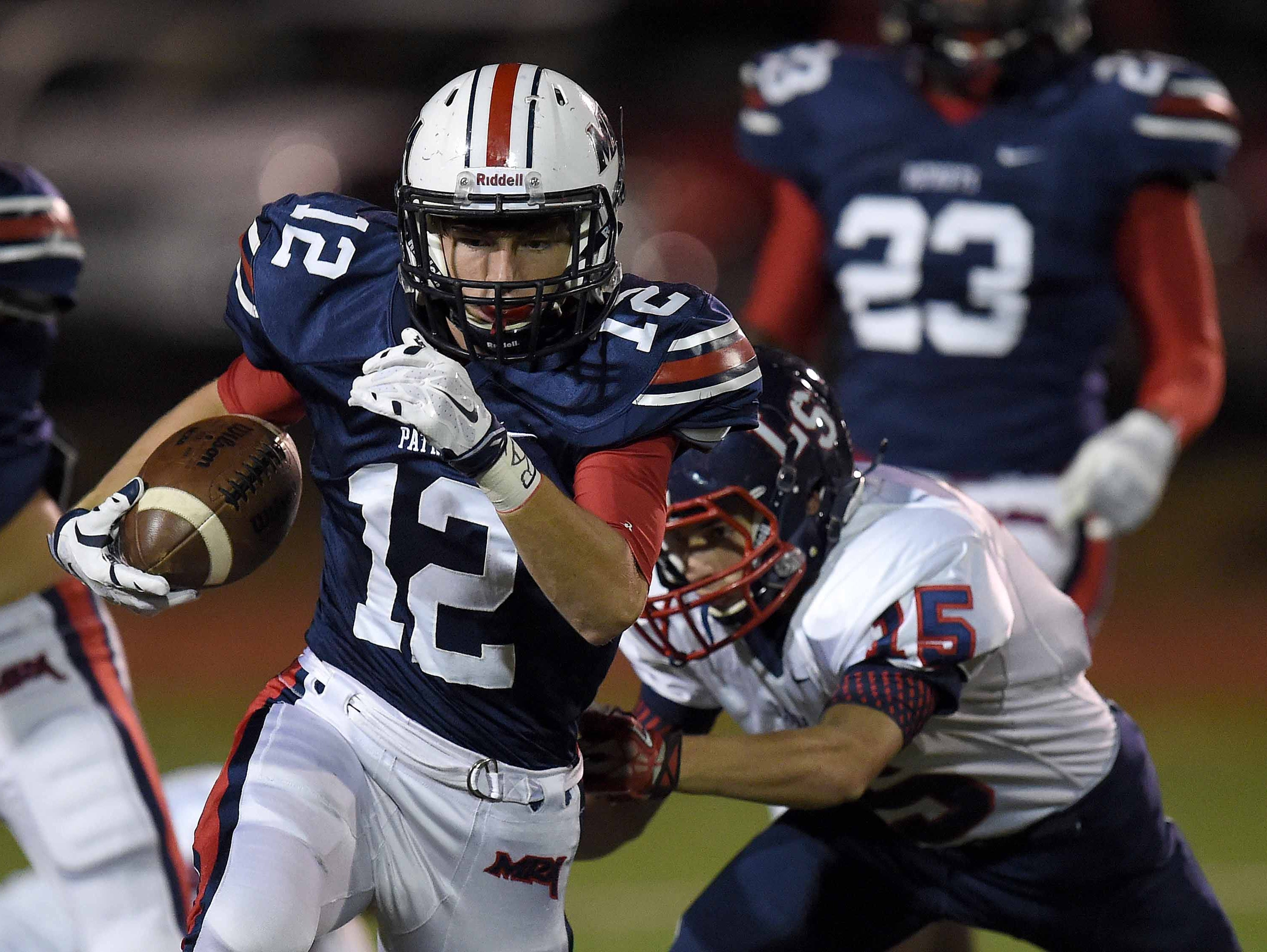 MRA's Kory Stephens (12) returns a kick getting past Lamar's Branson Acton (15) on Friday, October 30, 2015, at Madison-Ridgeland Academy in Madison, Miss.