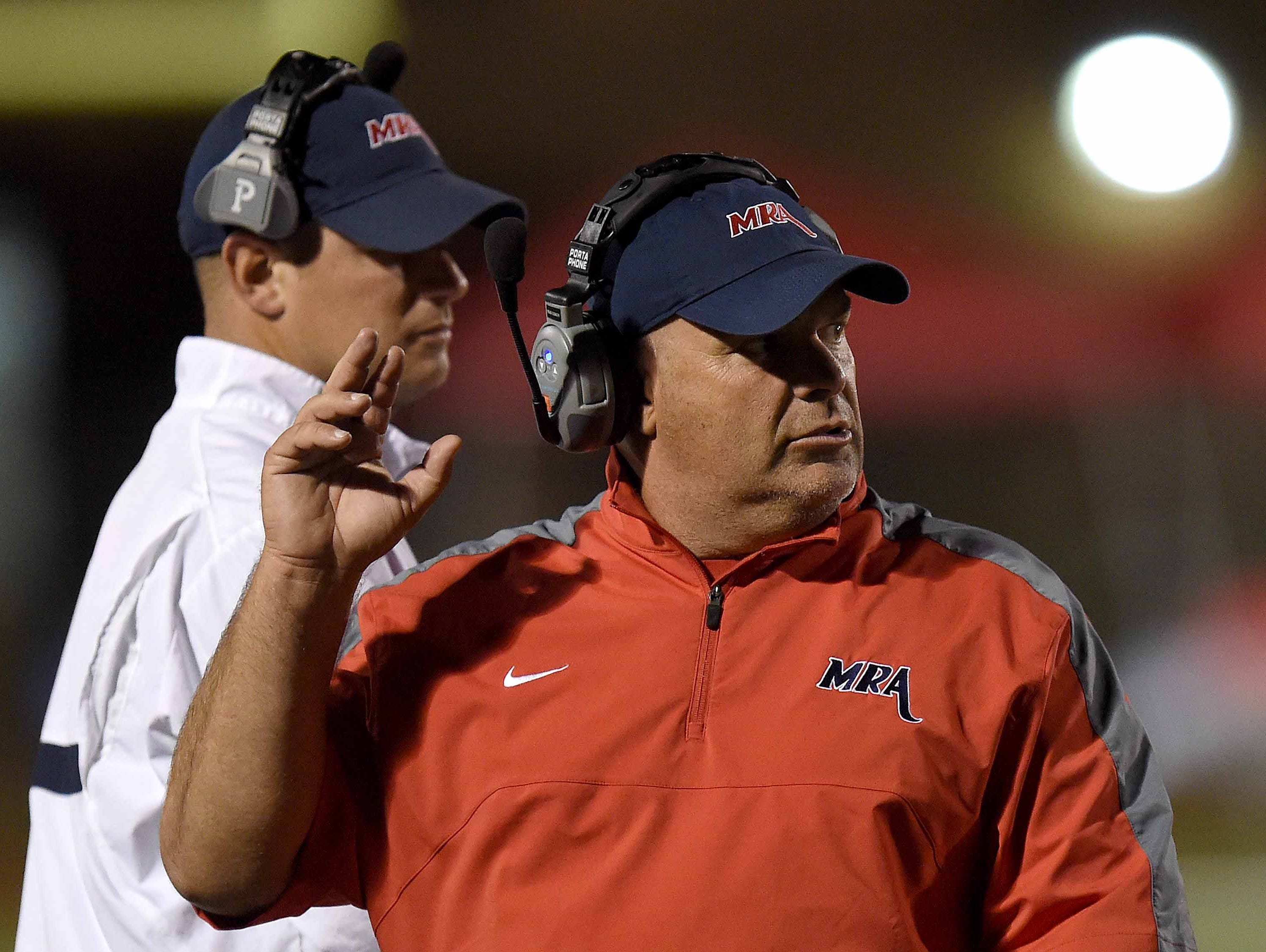 MRA head coach Herbert Davis guides the Patriots against the Lamar Raiders on Friday, October 30, 2015, at Madison-Ridgeland Academy in Madison, Miss.