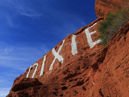 """Although the word """"DIXIE"""" on the Sugarloaf was originally painted for Dixie College and is now maintained by Dixie High School, many look at it as a symbol of the entire community of Utah's Dixie."""