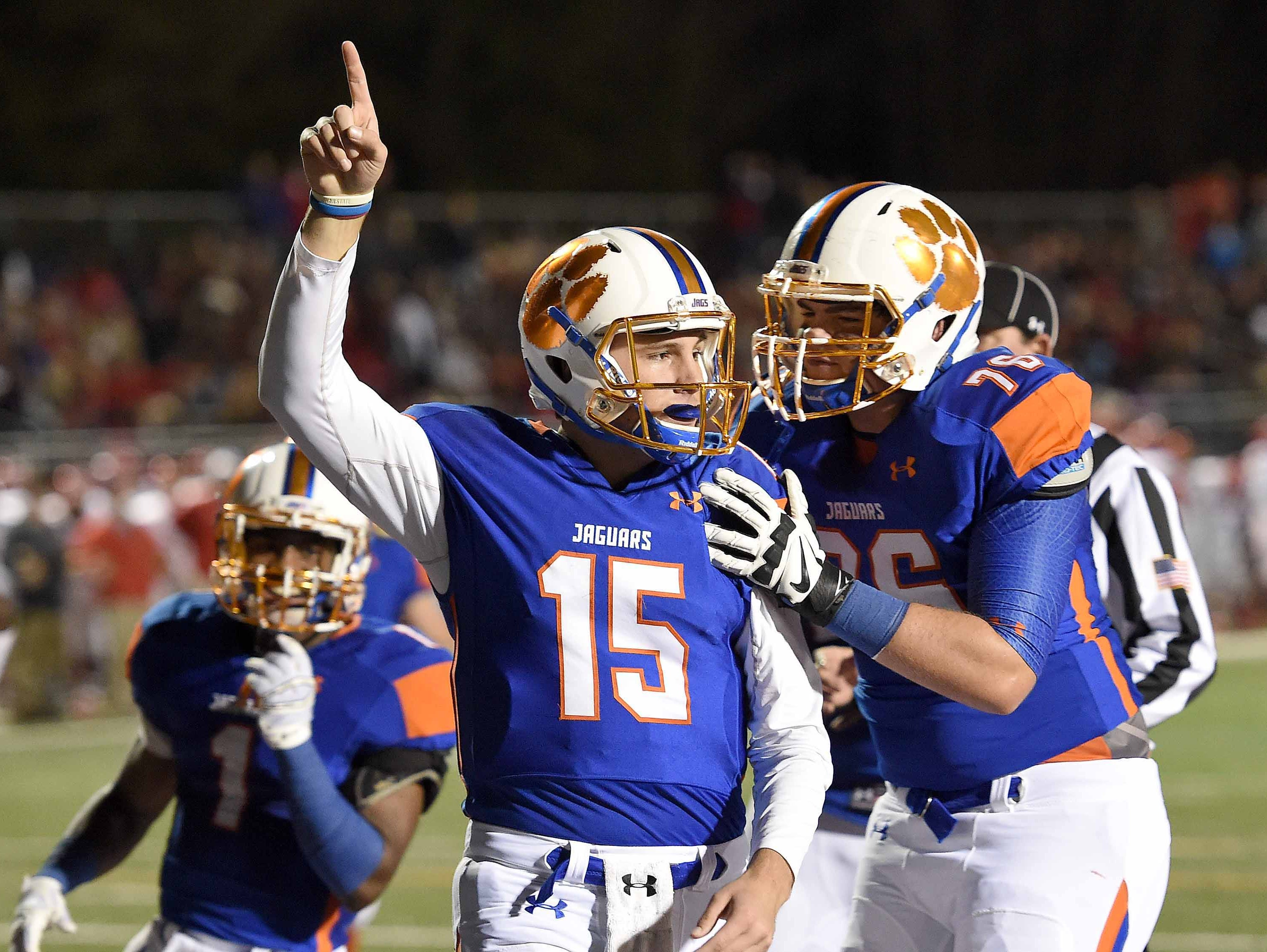 Madison Central quarterback Jack Walker (15) and the Jaguars will look to keep their dream post-season alive against Starkville this Friday night.