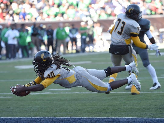 Charleston quarterback Ahmad Alexander (10) scores to put the Tigers up over Collins with less than a minute left in the game on Saturday, December 5, 2015, in the MHSAA Class 3A State Football Championship in Vaught-Hemmingway Stadium on the Ole Miss  campus in Oxford, Miss.